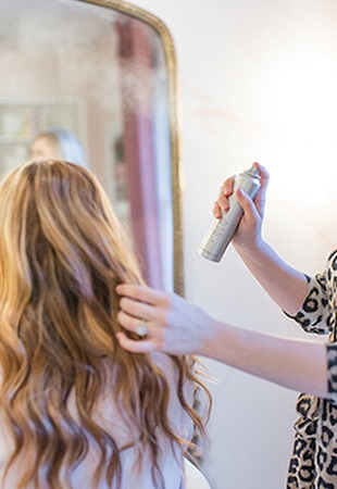 hairstylist spraying hairspray