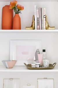Well Styled Decorated Shelves with Interesting Books, High End Makeup and Hair Products, Lovely Decorations