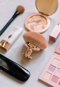 Overhead Shot of Huda Beauty Palette, Rose Gold Makeup Brush, Marc Jacobs Palette, Charlotte Tilbury Makeup