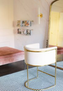 Beautiful Studio with Floor Length Gold Mirror and Cream Colored Velvet Designer Chair and Tufted Pink Velvet Ottoman