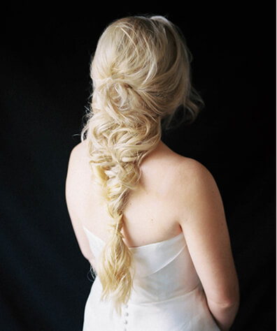 Blonde Model with long fishtail braids loosely pulled together