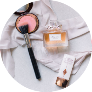 Overhead Shot of Dior Perfume, Charlotte Tilbury Makeup