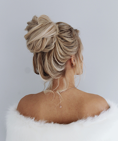 Model with Soft Locks Tied into High Bun