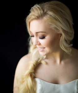 Blonde Model with beautiful fishtail braid and great makeup