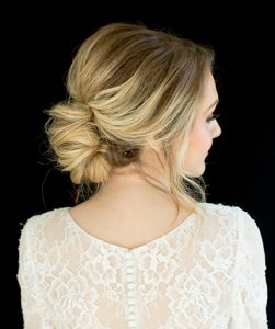 Blonde model with rounded bun and slight bouffant