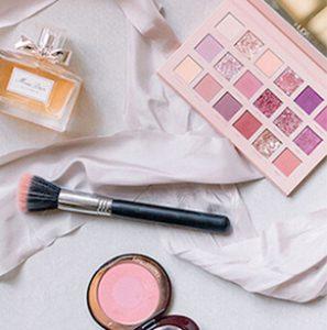 Overhead Shot of Dior, Guerlain, Huda Beauty Makeup and Perfume